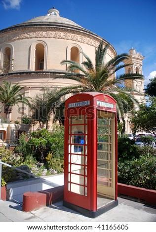 Phone box outside Mosta Dome Malta - stock photo