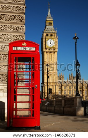 Phone box with the Palace of Westminster in the background. - stock photo