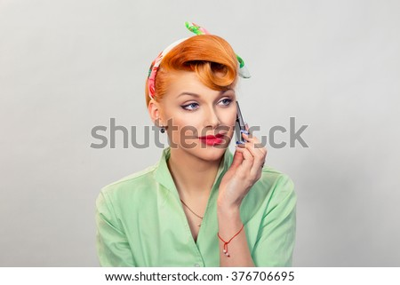 Phone conversation. Beautiful attractive girl business woman retro pinup style talk on cellphone formal green shirt isolated grey background wall. Positive human face expression emotion body language - stock photo