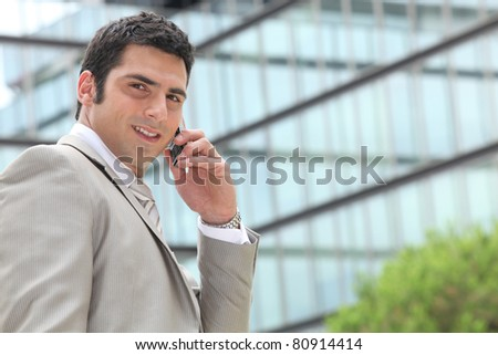 Phone conversation outdoors - stock photo