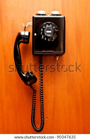 Phone hangs on a wall - stock photo
