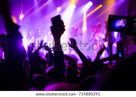 Phone in hand to record video at a concert. Stream