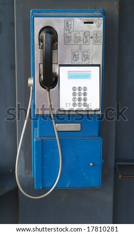 Phone in phone box - stock photo