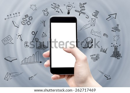 phone in the hand with a blank screen and drawings of a business around - stock photo