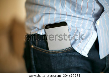 Phone in your pocket - stock photo