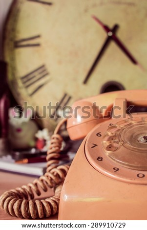 Phone old and vintage wood background. - stock photo