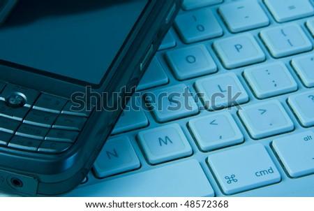 Phone on keyboard - stock photo