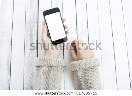 phone smartphone in hand white vintage wooden background
