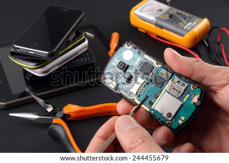 Phone to be repaired - stock photo