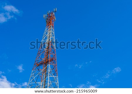 phone tower in blue sky. - stock photo