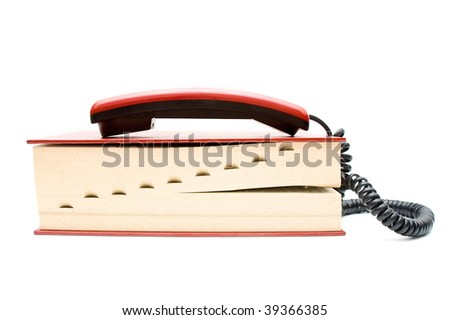 Phone tube with dictionary on white background - stock photo