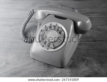 Phone vintage on wooden - stock photo