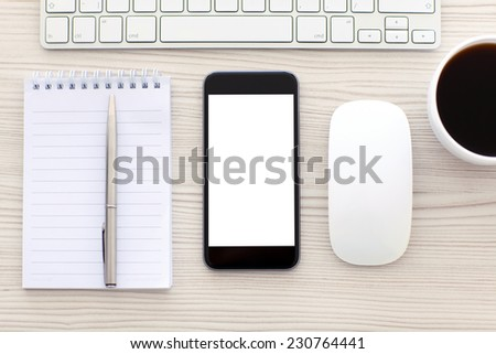phone with isolated screen is on the table in the office - stock photo