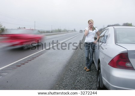 phoning for tow - stock photo
