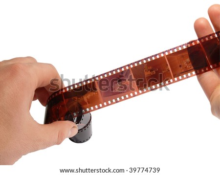 Photo a film on a white background in hands - stock photo