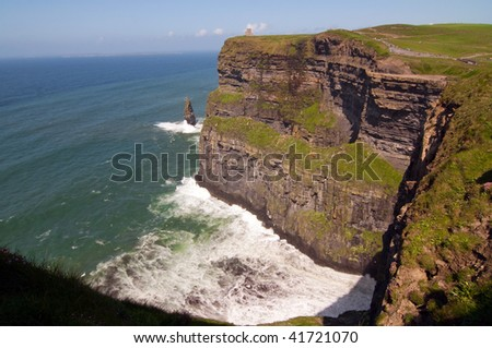 photo afternoon capture of the cliffs of moher, ireland - stock photo
