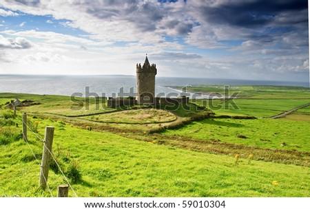 photo ancient old irish castle in doolin, ireland - stock photo