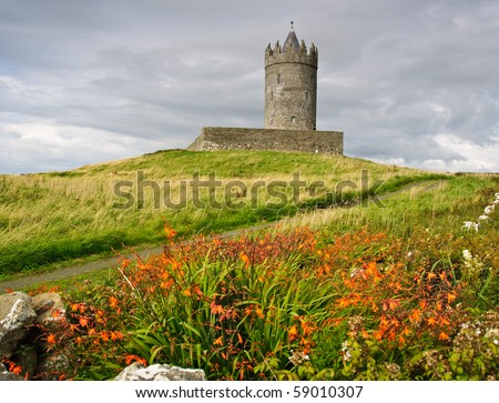 photo ancient old irish castle in doolin, ireland. Doonagore castle and 500 year old Doonmacfelin castle in Doolin Co Clare