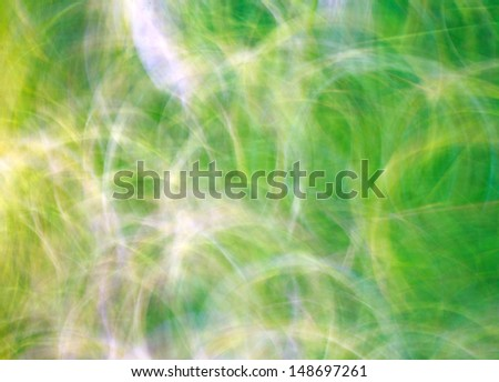 Photo art, bright Colorful light streaks abstract background in yellow and green colors - stock photo