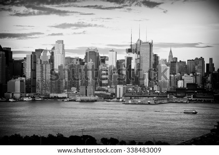 photo b&w late afternoon midtown nyc over hudson river - stock photo