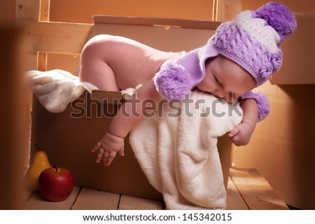 Photo baby in the mail box - stock photo