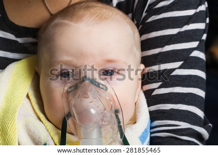 Photo baby inhalation nose close-up portrait - stock photo