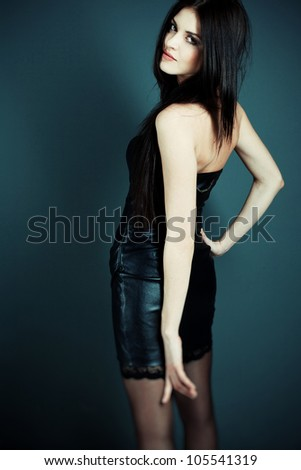 Photo Beautiful sexy girl in leather dress in the studio - stock photo