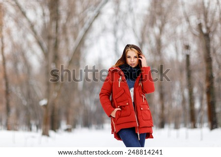 Photo beautiful woman in winter park.Outdoor - stock photo