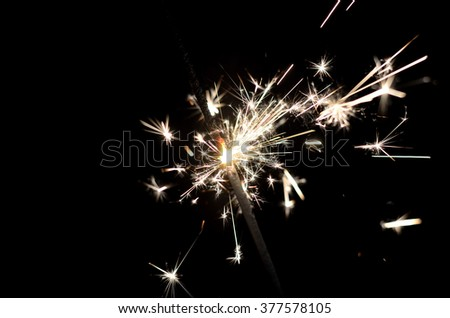 Photo Bengal fire close-up. Bright lights. Celebrate with a sparkler - stock photo