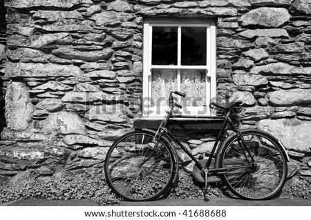 photo bicycle outside a rural old cottage in ireland