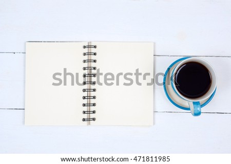 Photo blank book cover on textured wood background with cape of coffee