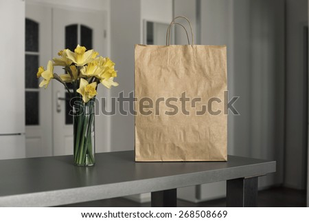 Photo blank: disposable bag of kraft paper on a wooden table - stock photo