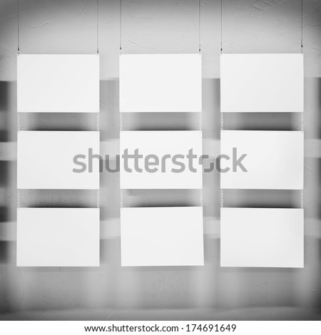 Photo blank. Gallery Interior with empty sheets on wall - stock photo