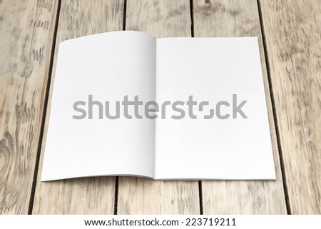 Photo blank. Open a4/a5 format brochure on a wooden texture  - stock photo