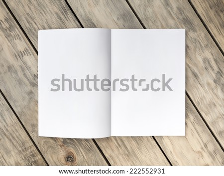 Photo blank. Open A4 format brochure on a wooden texture - stock photo