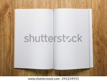 Photo blank. Open brochure on a wooden table - stock photo