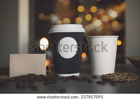 Photo blank paper cup of coffee and business card coffee shop to apply logo - stock photo