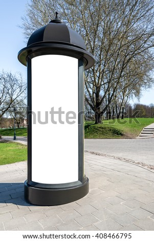 Photo blank white mockup of retro style street advertising column stand on sidewalk