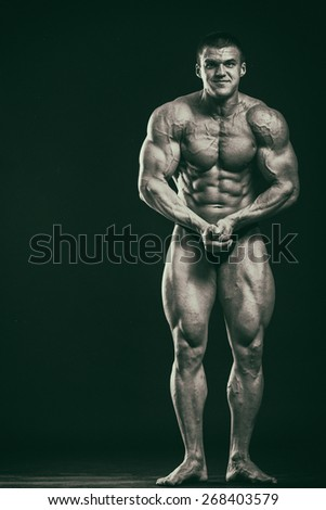 Photo bodybuilder on a black background. Man showing muscles. Photos in creative. - stock photo