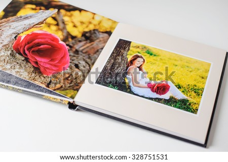 Photo book of young couple, pregnancy and expectation. - stock photo