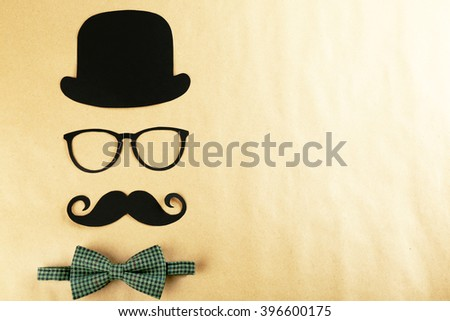 Photo booth props glasses, mustache, bow tie and bowler - stock photo