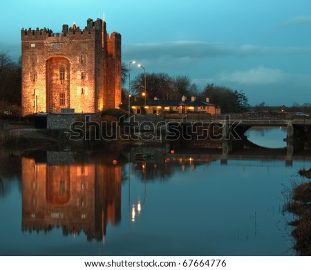 photo breathtaking bunratty castle in west of ireland at night - stock photo