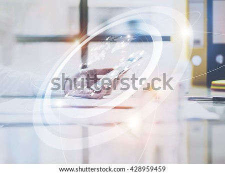 Photo business woman wearing white shirt, touching screen modern smartphone.Open space loft office.Panoramic windows background.Connections world wide interfaces.Horizontal,flares.Film effect