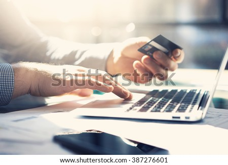 Photo businessman working with generic design notebook. Online payments, banking, hands keyboard. Blurred background, film effect. horizontal mockup - stock photo