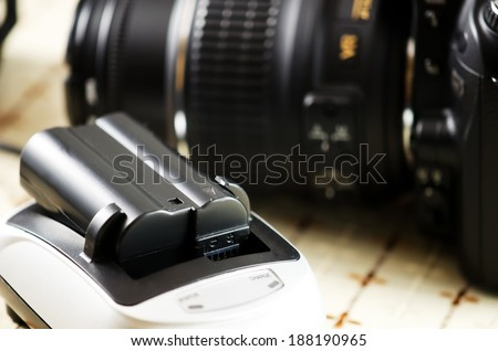 Photo camera acumulator and charger. - stock photo