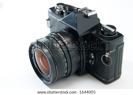 Photo camera and camera lens on white - stock photo