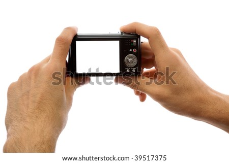 Photo camera in hands isolated on white background - stock photo