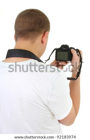 photo camera in male hands over white