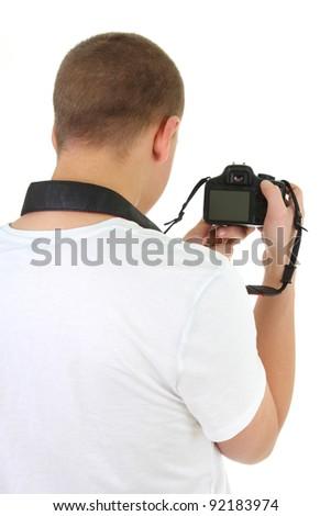 photo camera in male hands over white - stock photo