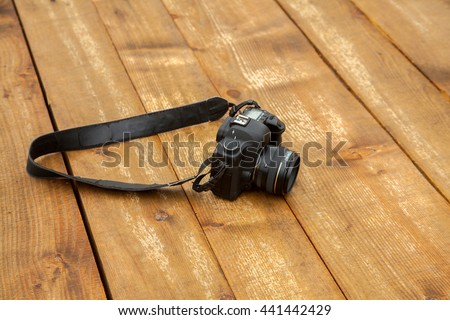 photo camera is in the untreated wooden floor